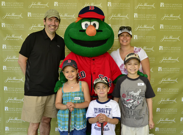 Nicholas Manz of Southborough and family pose with Wally the Green Monster. Photo courtesy of the Expect Miracles Foundation.